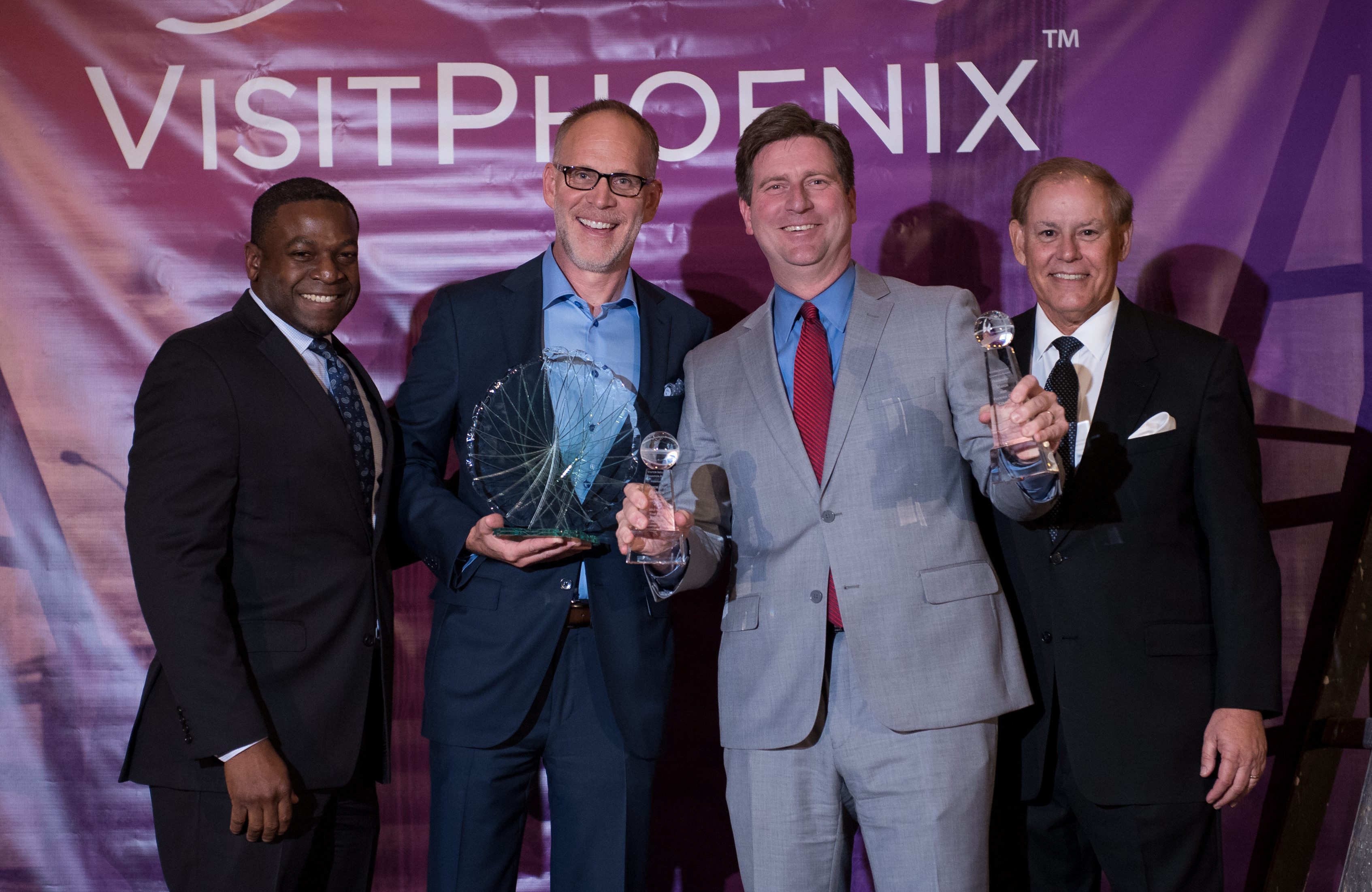 Roger Helms accepted the Visitor Industry Champion Award on behalf of the HelmsBriscoe team.